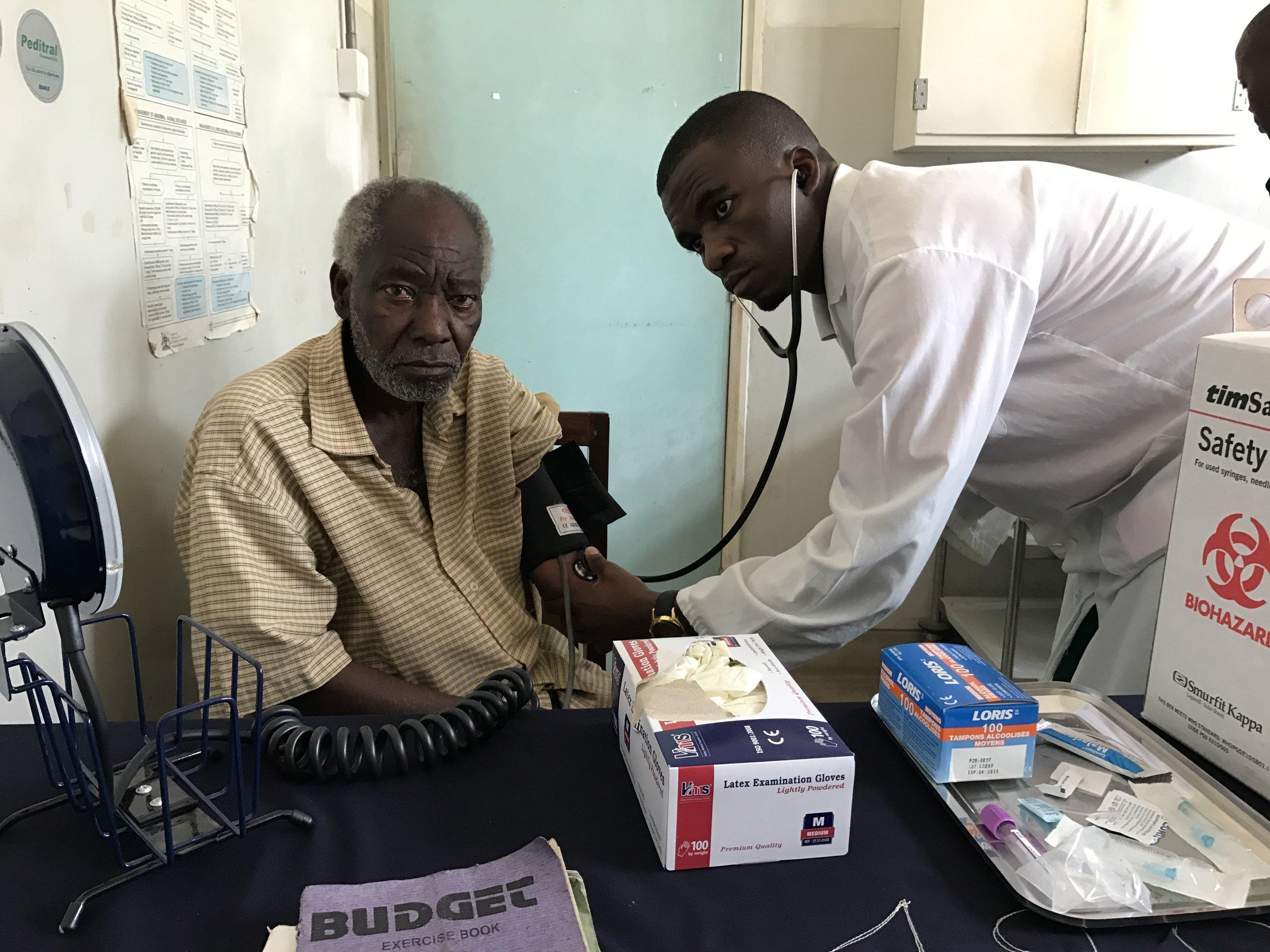 A chronic disease patient having his blood pressure taken.