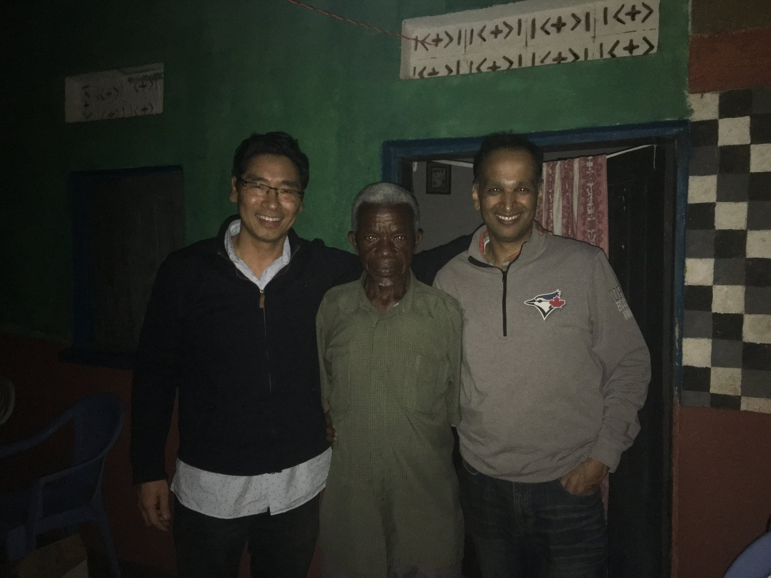 Dr. James and Dr. Rajiv with our host, John's father.