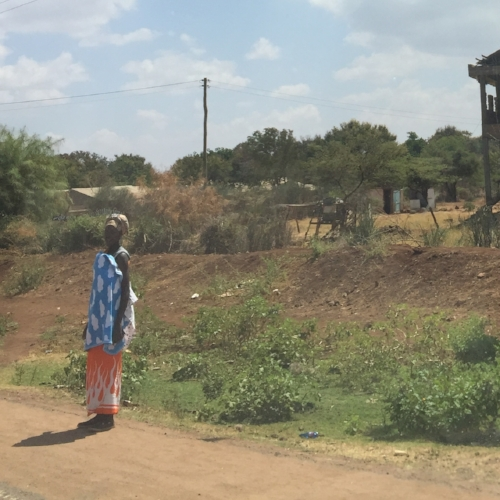 Woman standing by road en route to Isiolo Hospital
