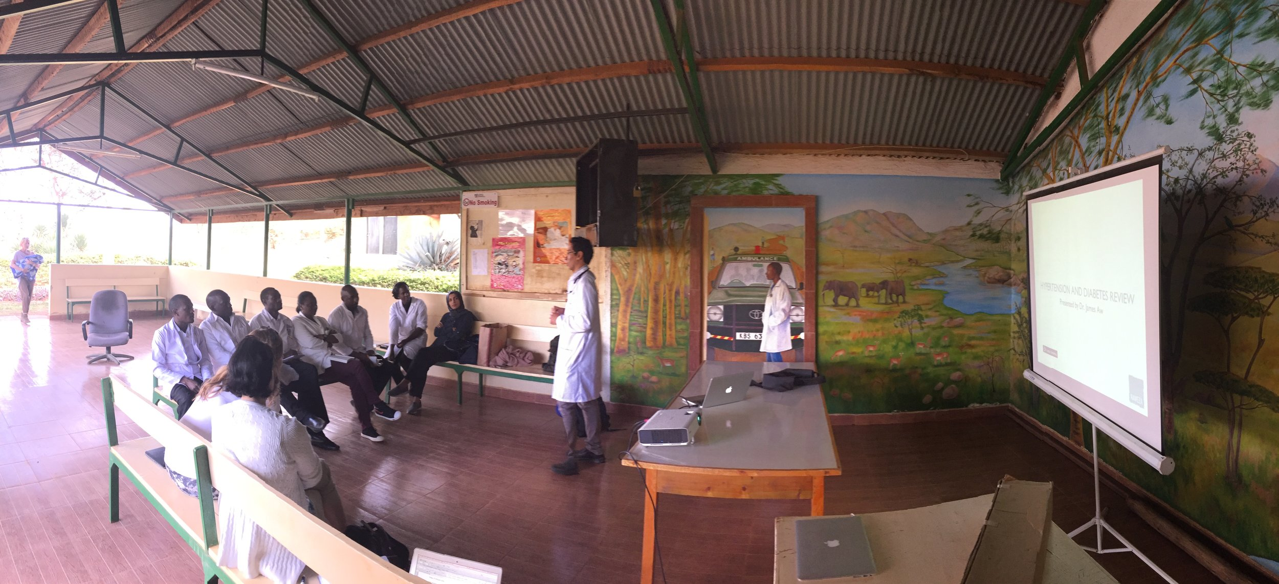 Dr. James starts off the CME sessions in a open-air lounge area on the grounds of the Lewa clinic