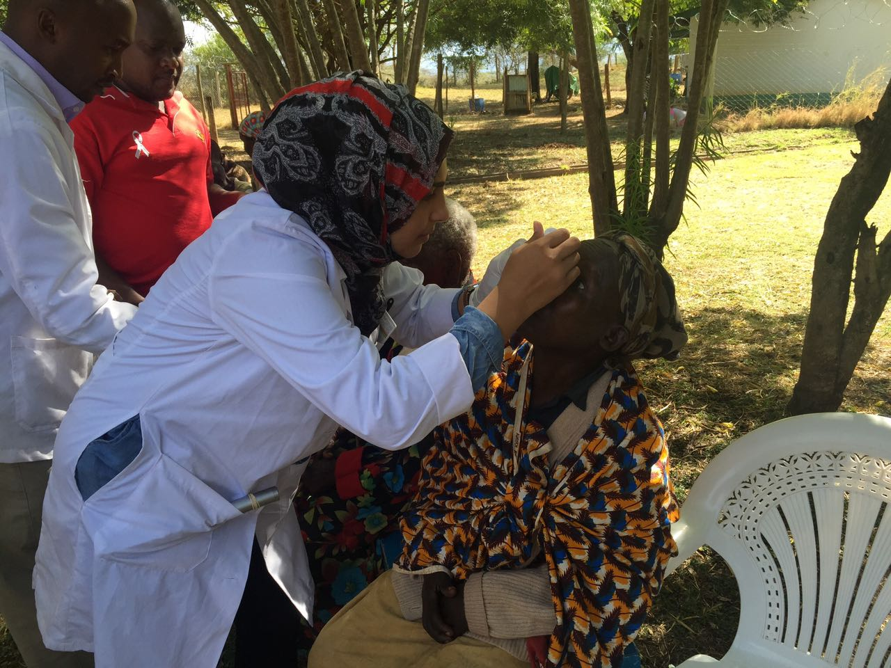 Dr. Sidiqa performing post-cataract treatment on patients in 2016 at the Isiolo Hospital