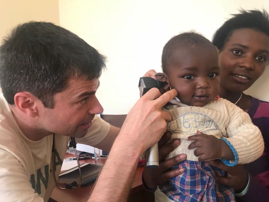 Dr. Michael examining a young patient at yesterday's outreach