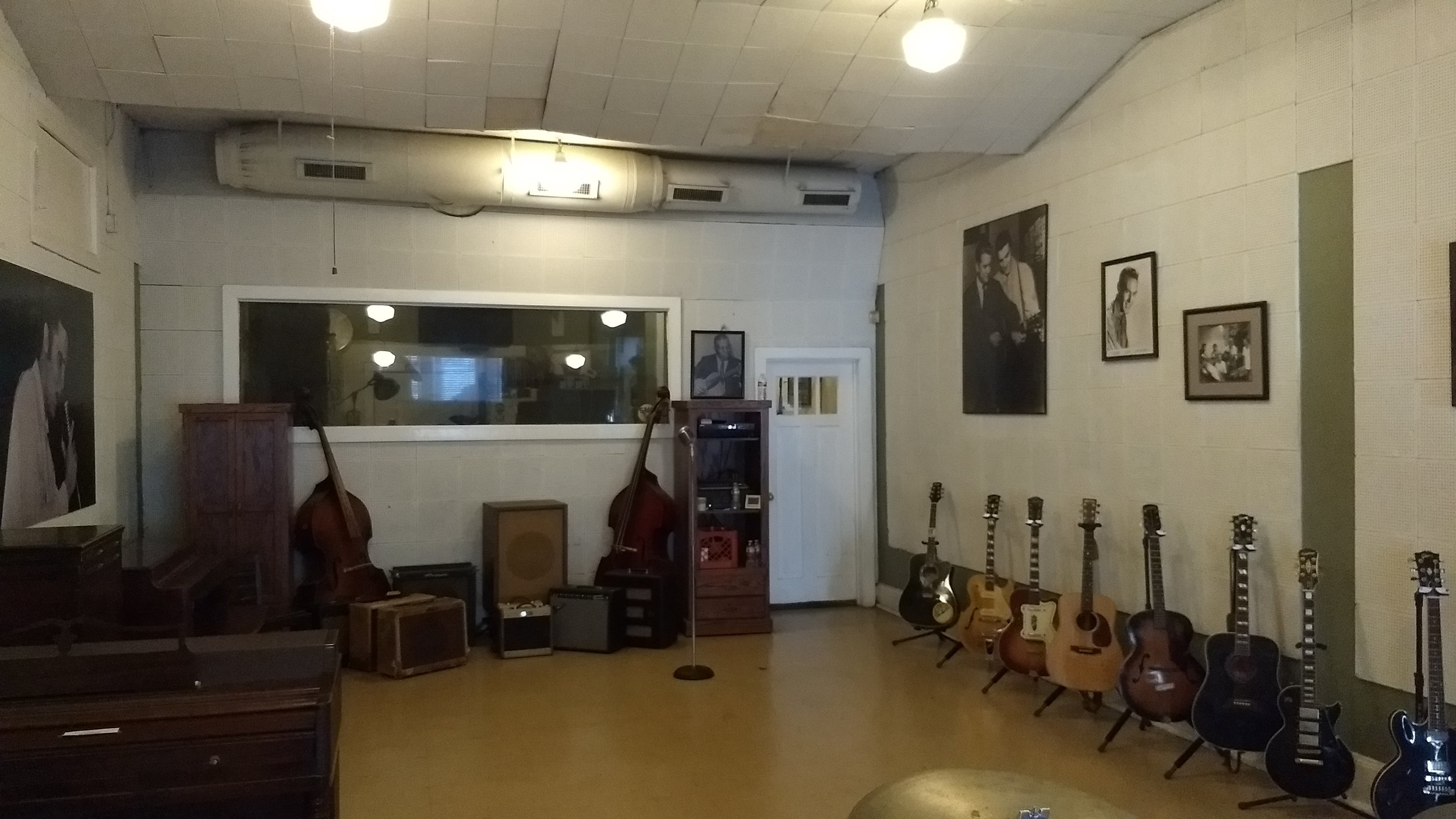 Sun Studio, the small black x next to the mic in the center is where Elvis originally stood when first recording here.
