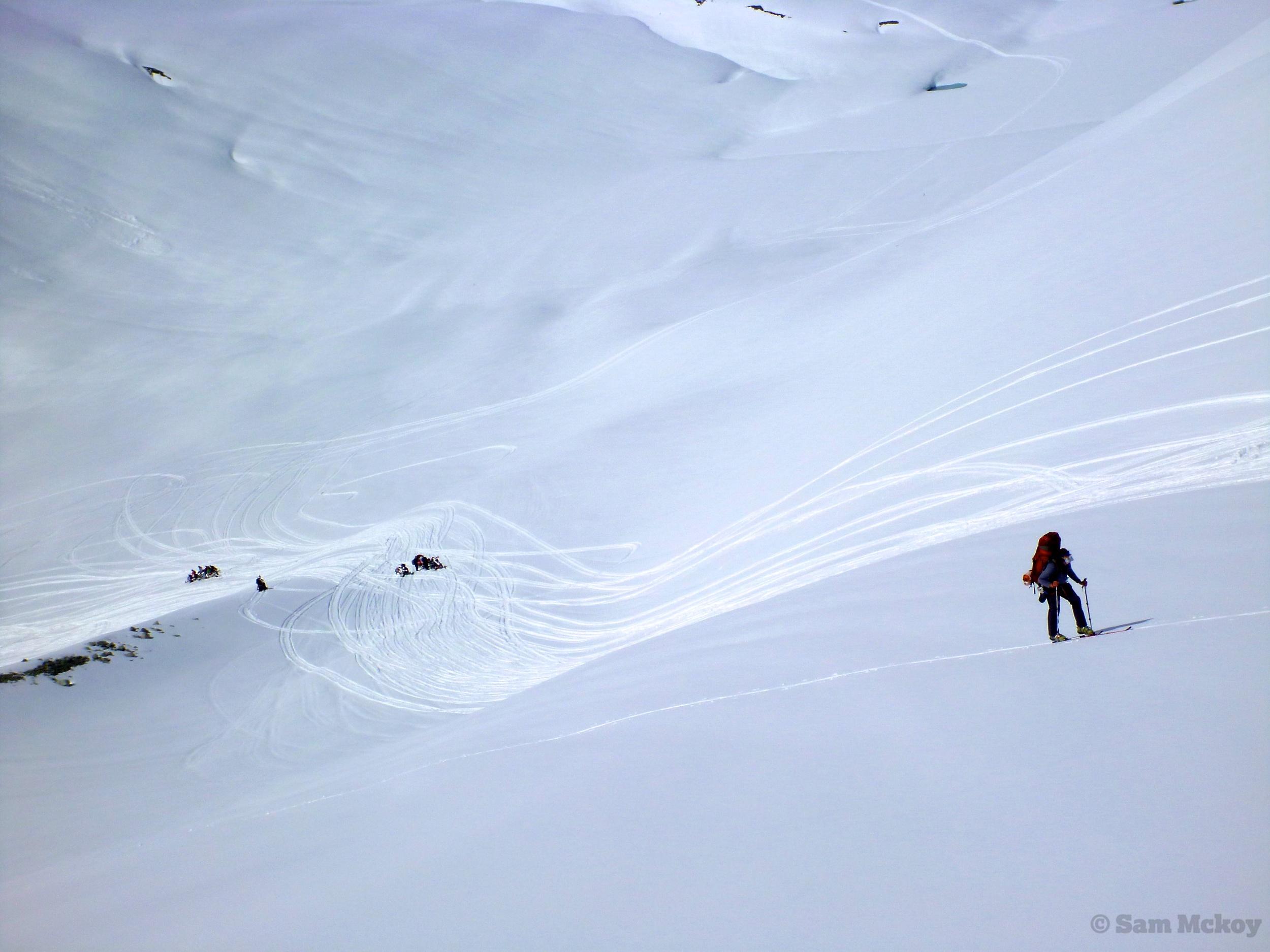 Ski touring around snowmobiles.