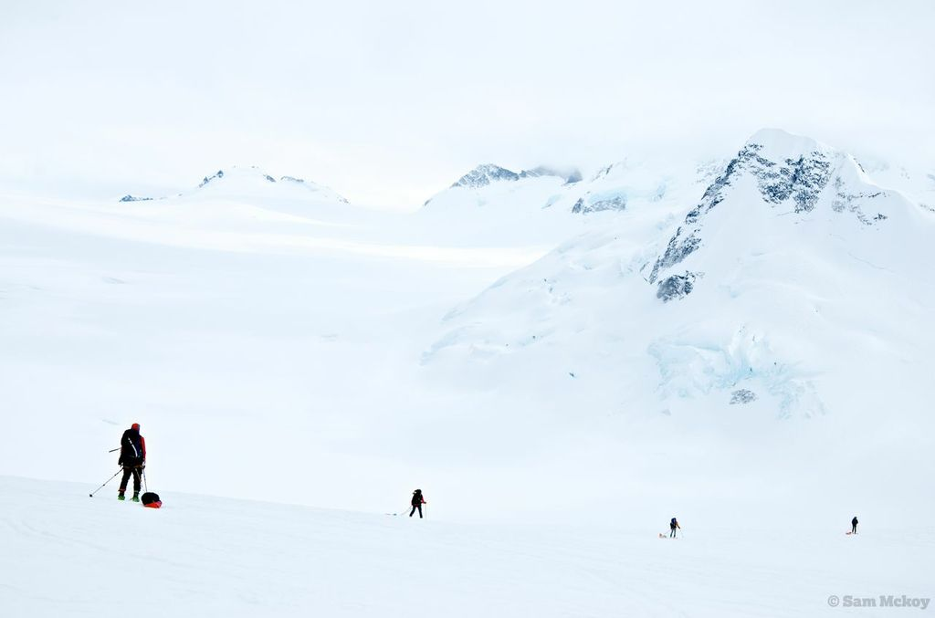 The group descending to our camp destination below Mount Satan (right) with the Monarch Icefield (left)
