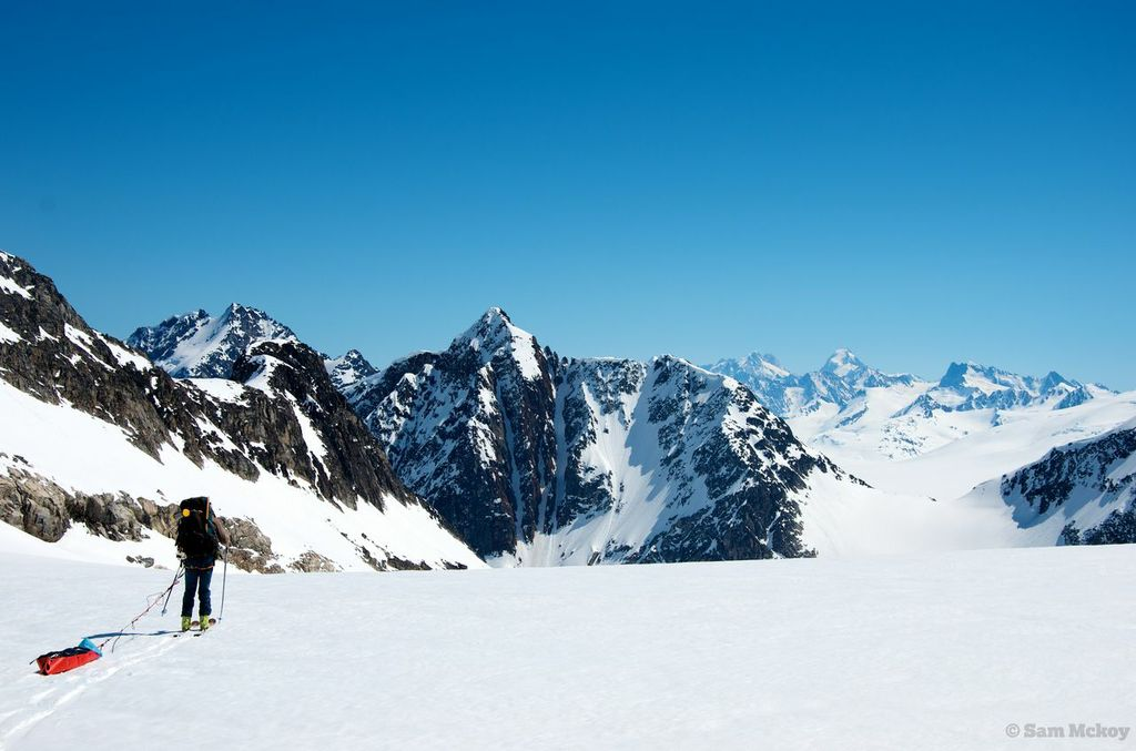 Tim with the Waddington range in the background and unnamed summits in the foreground.