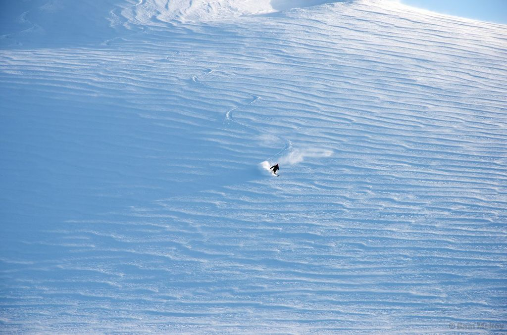 Artem skiing down from Erehwon after jumping over a small crevasse above out of frame.