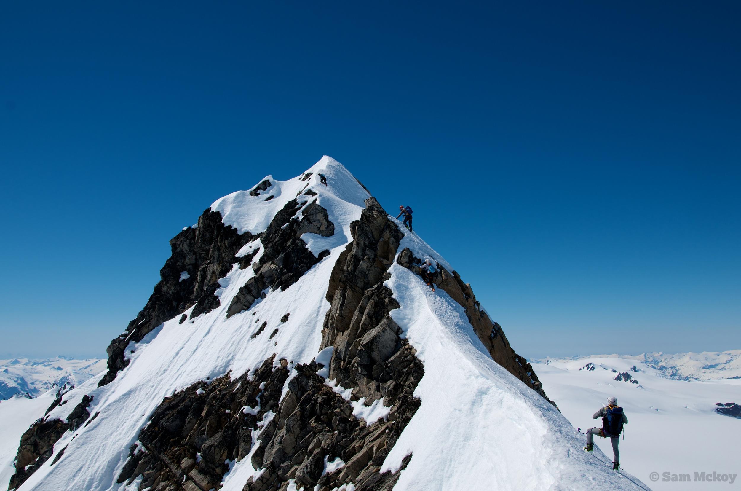 The group ascending the summit ridge of Somolenko.