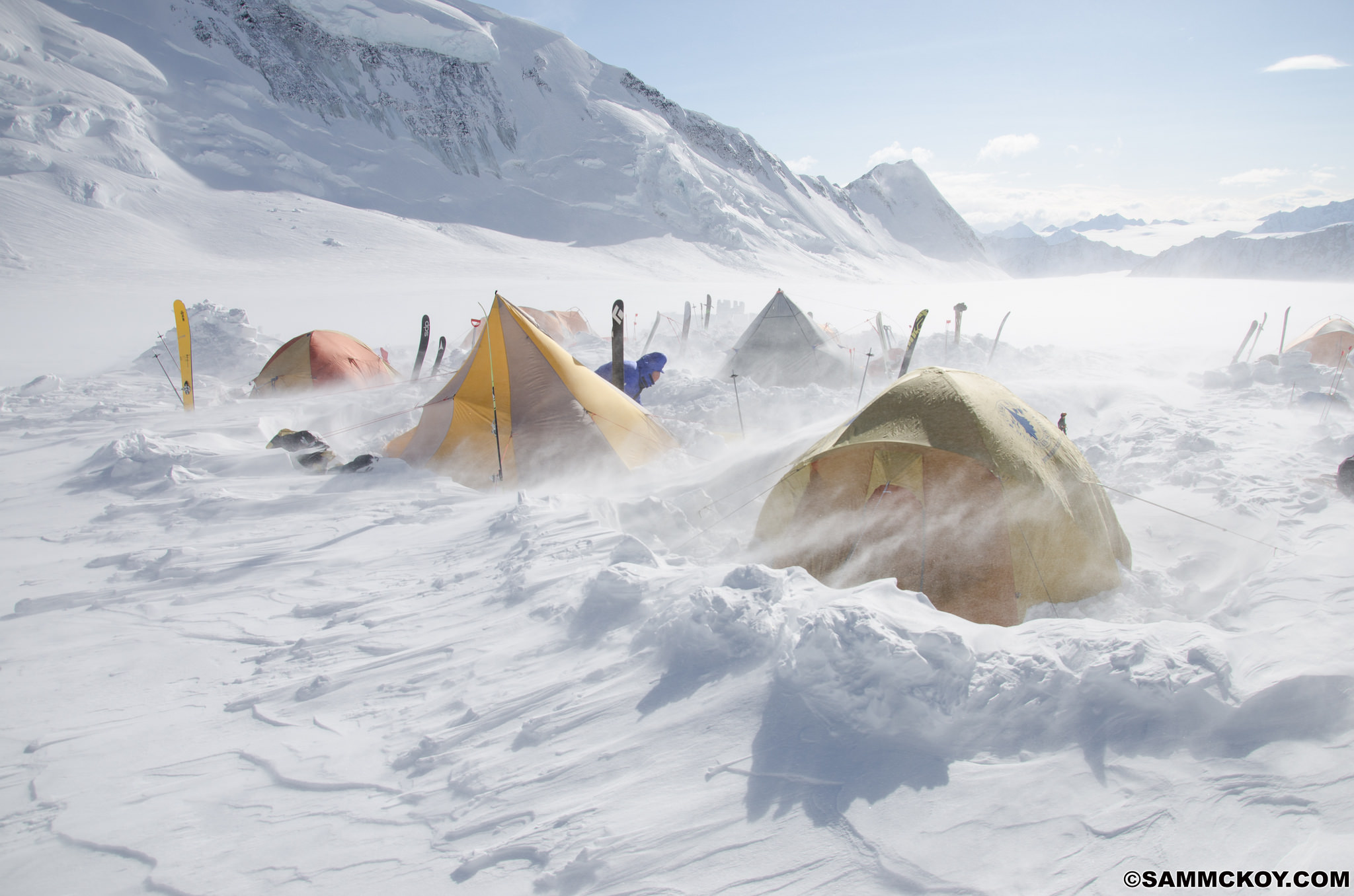 A windstorm at camp 1. The tents took the gale force winds well but anything downwind would fill in with snow. Snow-walls only proved annoying as they would cause snowdrift to settle behind and bury the tents.
