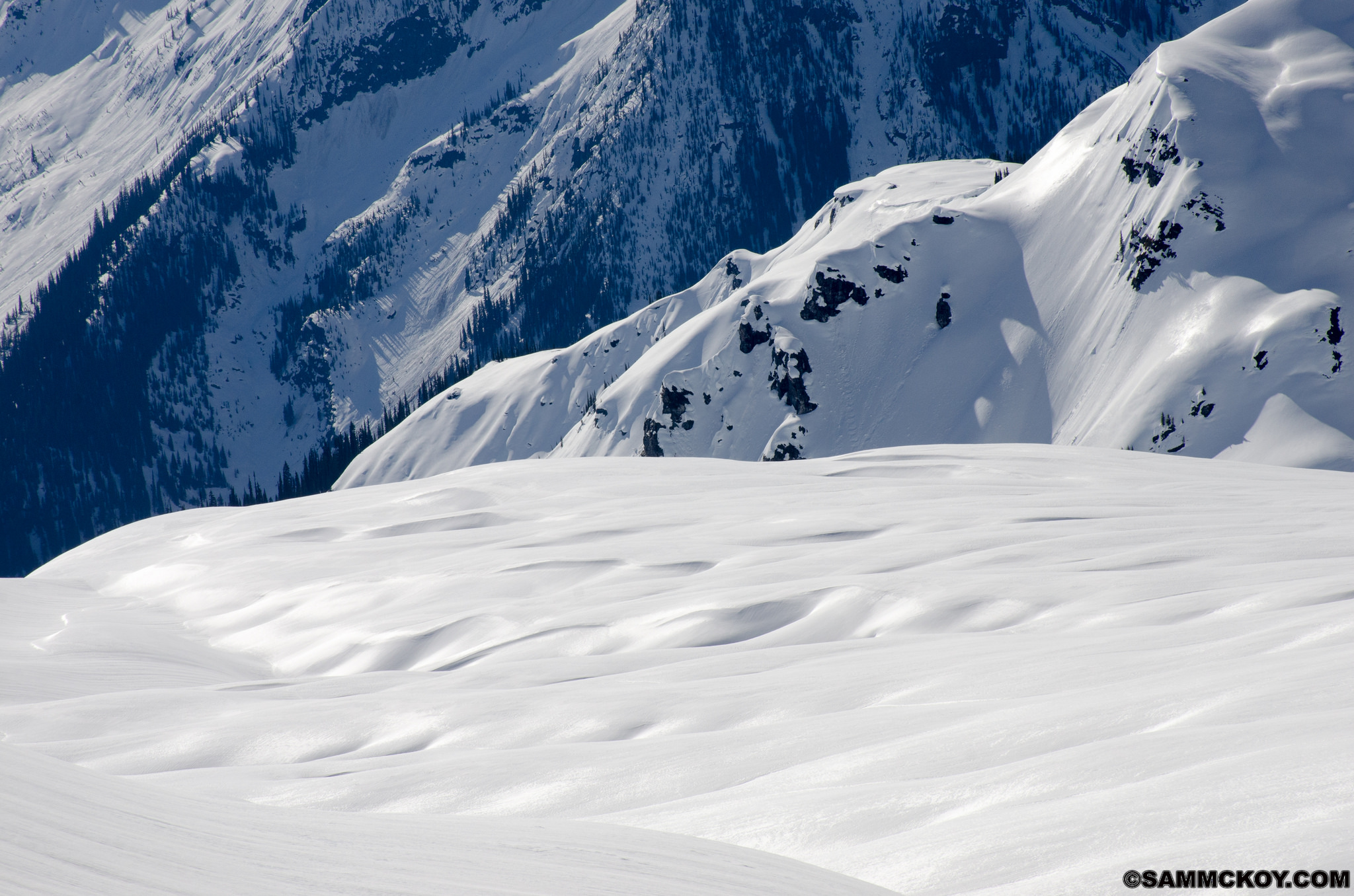 Sagging crevasses and wind formations on a glacier.