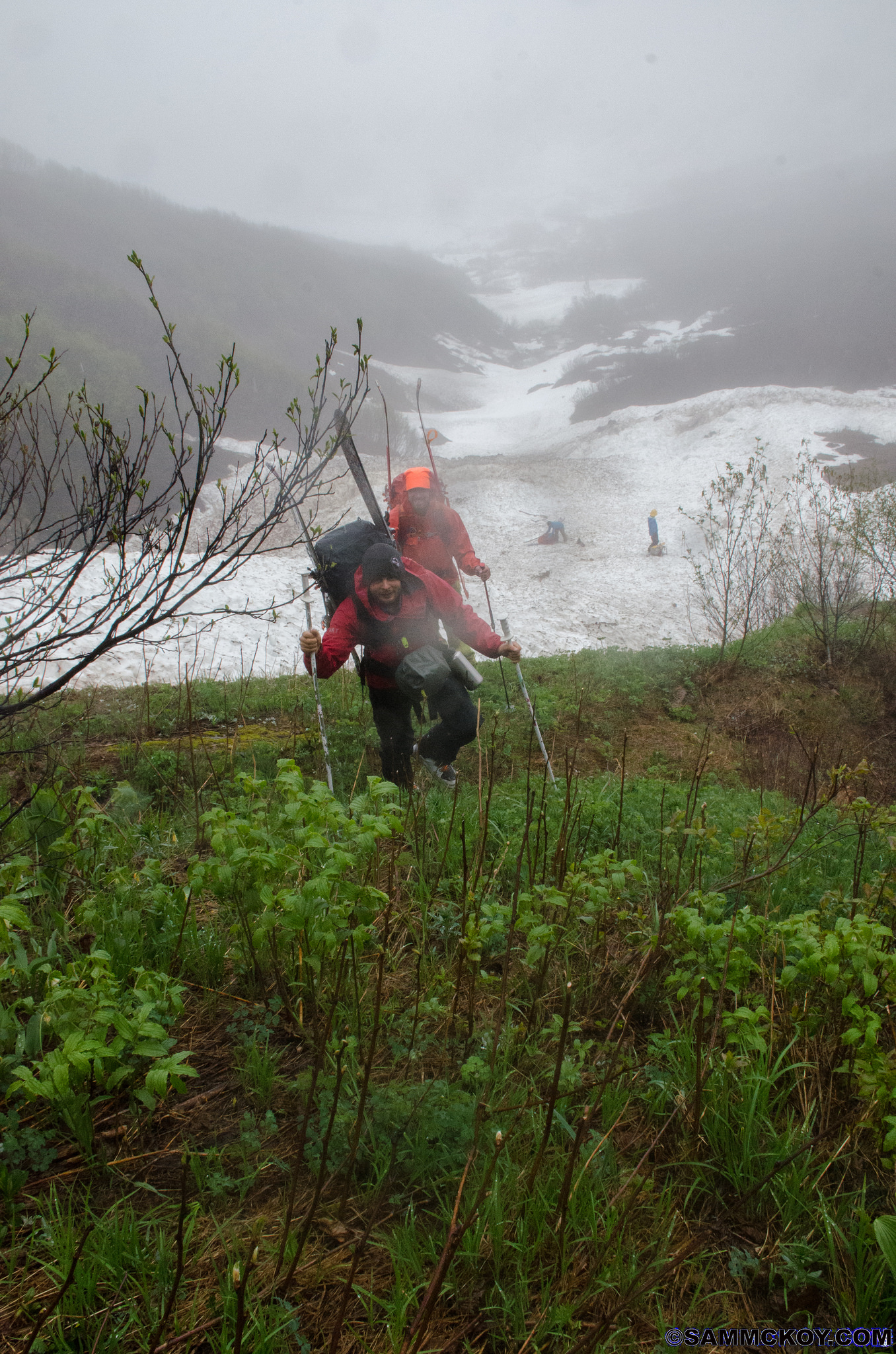 It might not fully be obvious but its raining hard. Notice the avalanche debris in the background. This was the only snow cover in the entire basin. Following this photo came some intense bushwacking where I couldn't muster any extra energy to take photos.