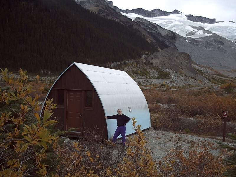 Roland Burton with his namesake hut during a fall renovation. Photo Christian Veenstra