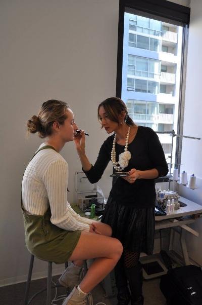 Preparing a runway model for  FIDM's  Fashion Club Event