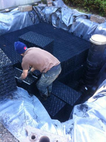 Installing the modular storage basin.