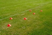 27724747-soccer-football-training-cones-for-marking-on-the-field-grass.jpg