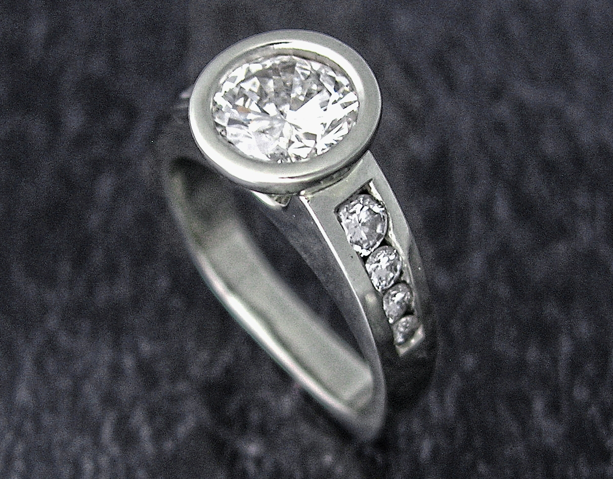 After:    The diamonds from the band are sorted for size and set into new ring. Finally the center stone is soldered to the top of the new ring. The ring is polished one more time, thoroughly cleaned and checked, and finally worn home by an elated client!