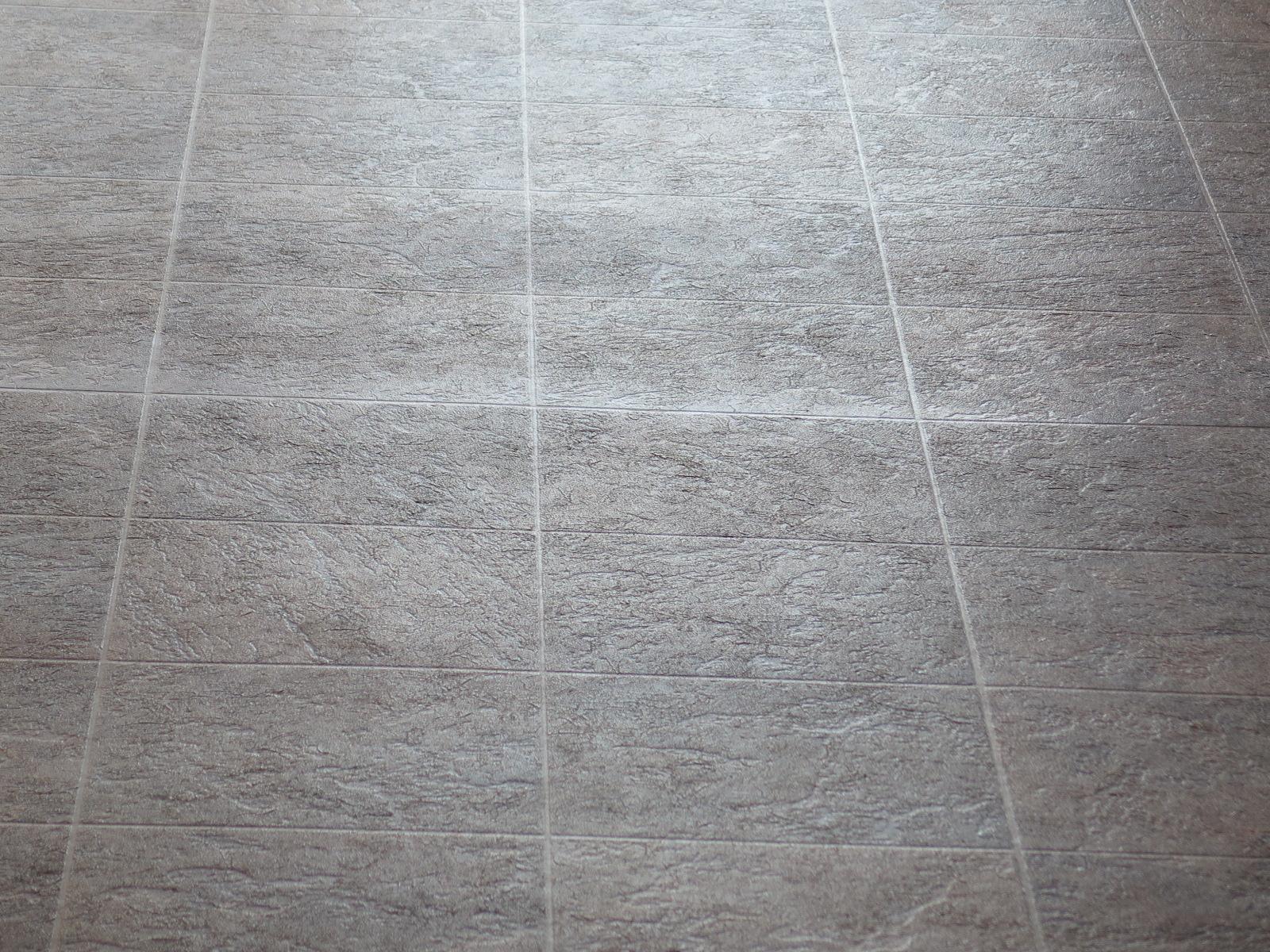 Sheen variation at sheet vinyl seam