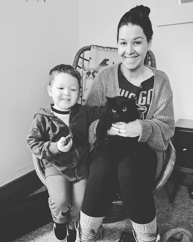 My kid, 8am, before school. Take a picture of us with Salami (the cat, obviously thrilled). Ok, Elliott. #awkwardfamilyphotos