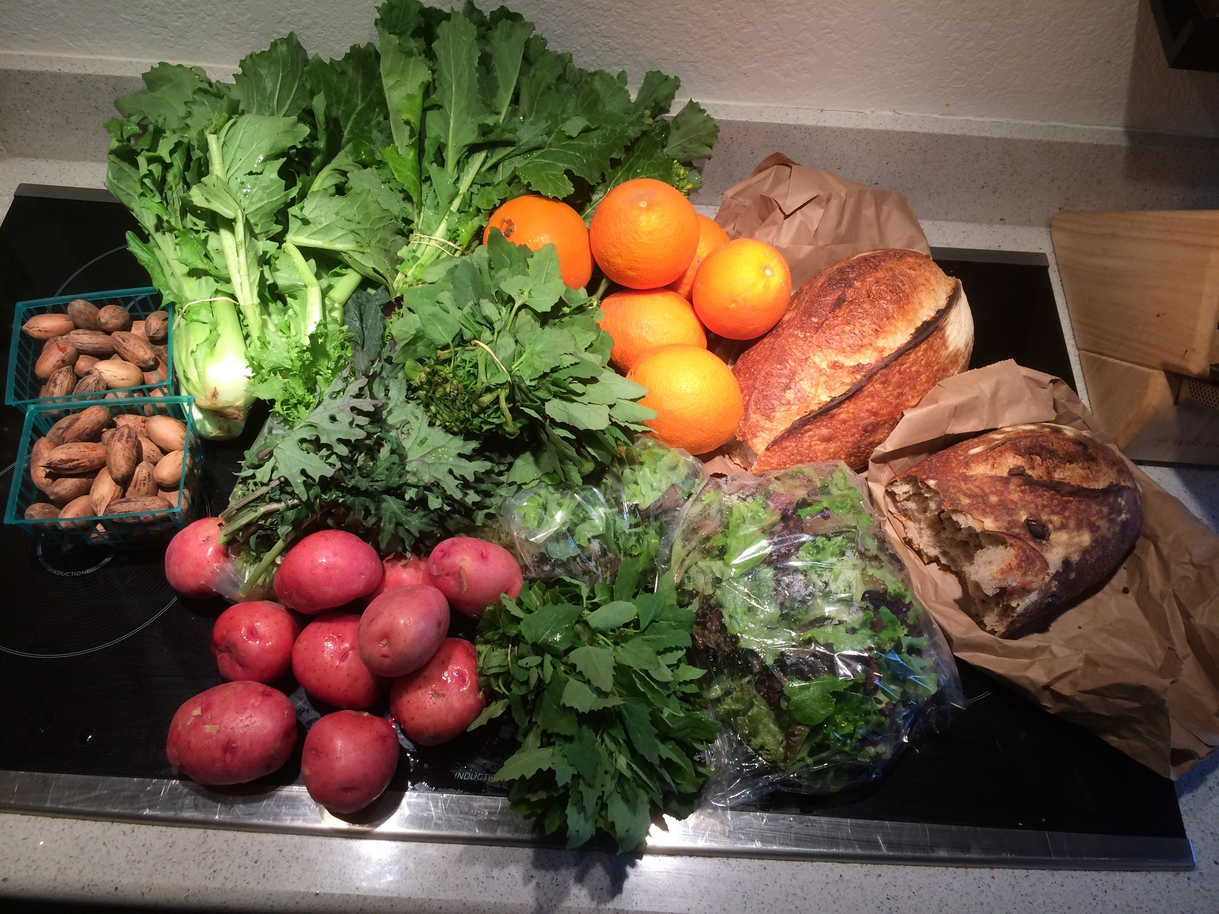One of our week's share at the CSA - Tons of greens at this time of year. The Bario Bread, which is a part of our share is also delicious!