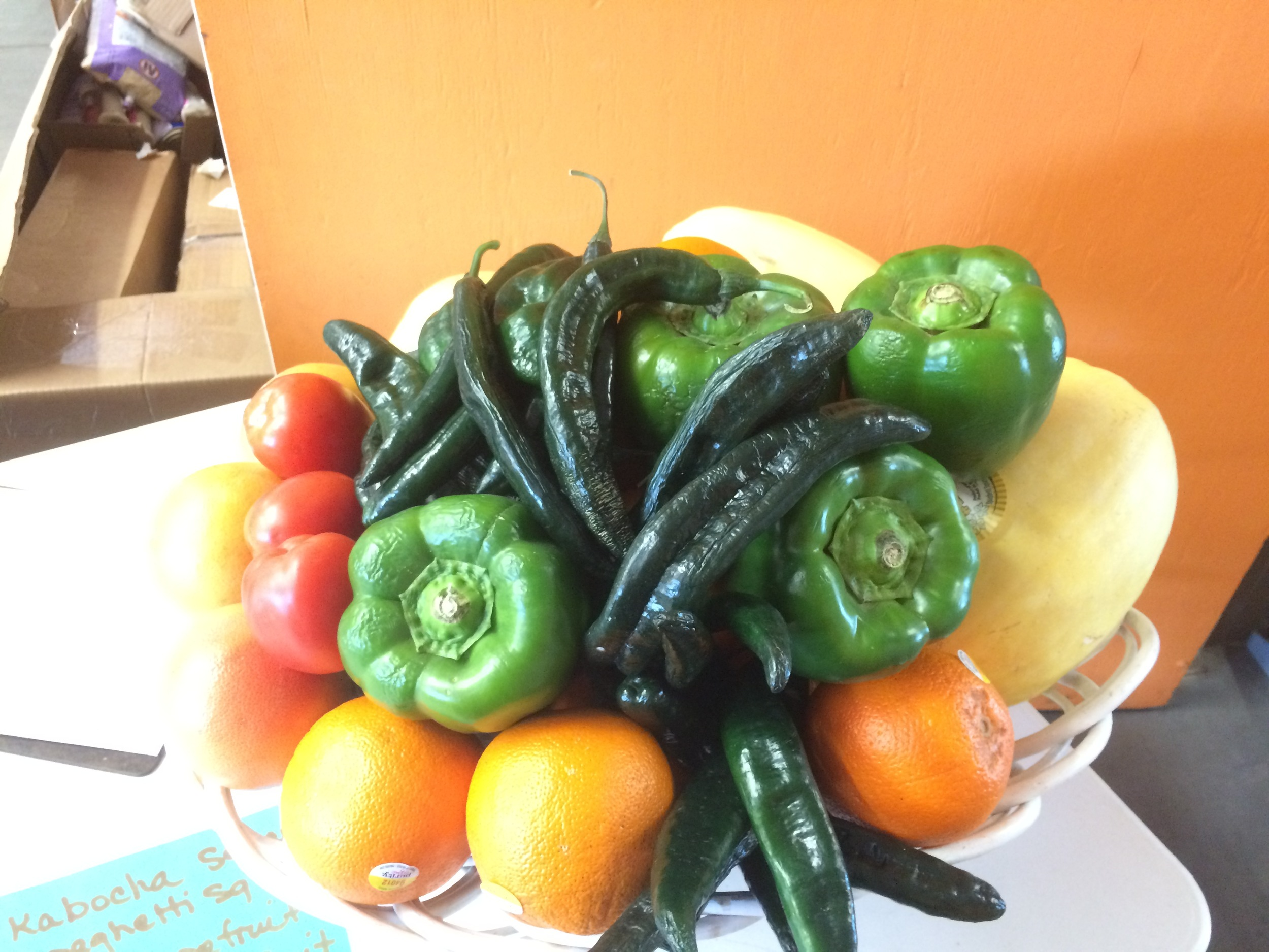 Second week pick up at the Market on the Move: 3 Spaghetti Squash, 3 tomatoes, 4 green bell peppers, 3 kabocha squash, 8 grapefruits and 10 oranges!