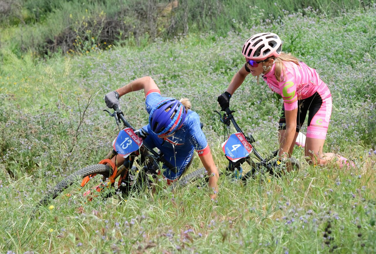 "Alexis goes around another rider on the singletrack climb. ""Brilliant, I'll do the same thing!"" Alexis messes up. I mess up too. ""Not so brilliant after all. Be patient Magh."" BY Dave McElwaine"