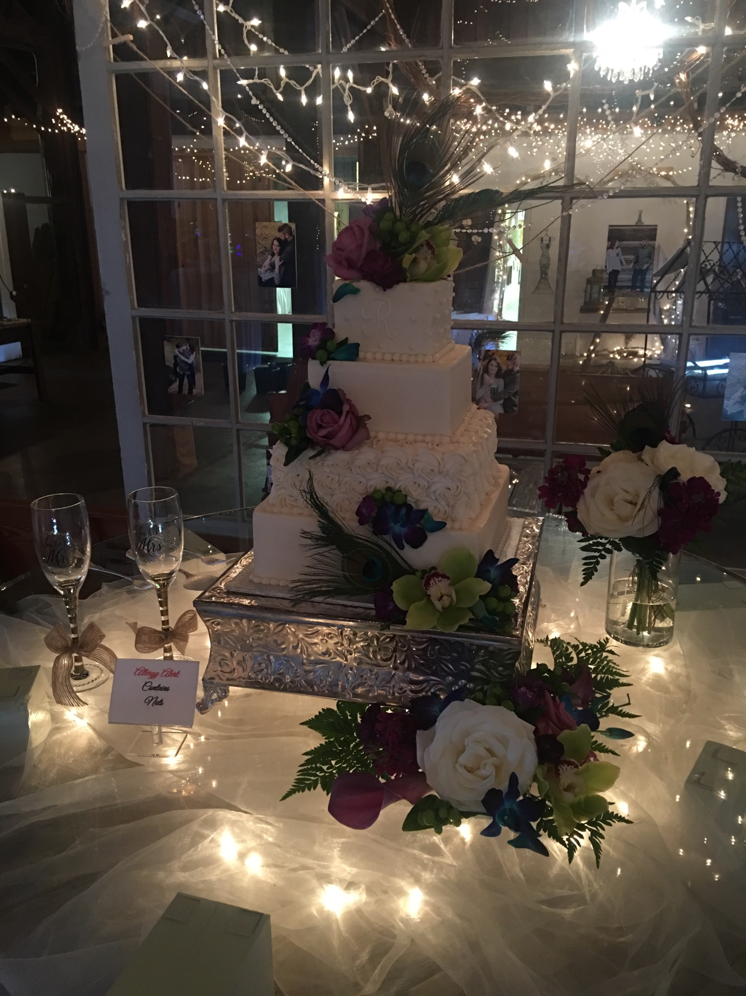 Beautiful wedding cake with window backdrop