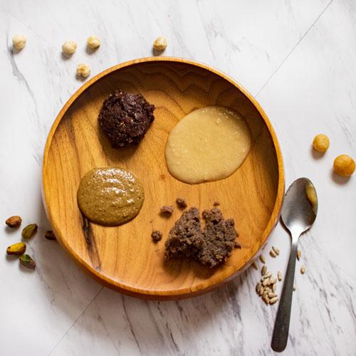 Clockwise from the top left: Hazelnut, macadamia, sunflower, Brazil + pistachio.