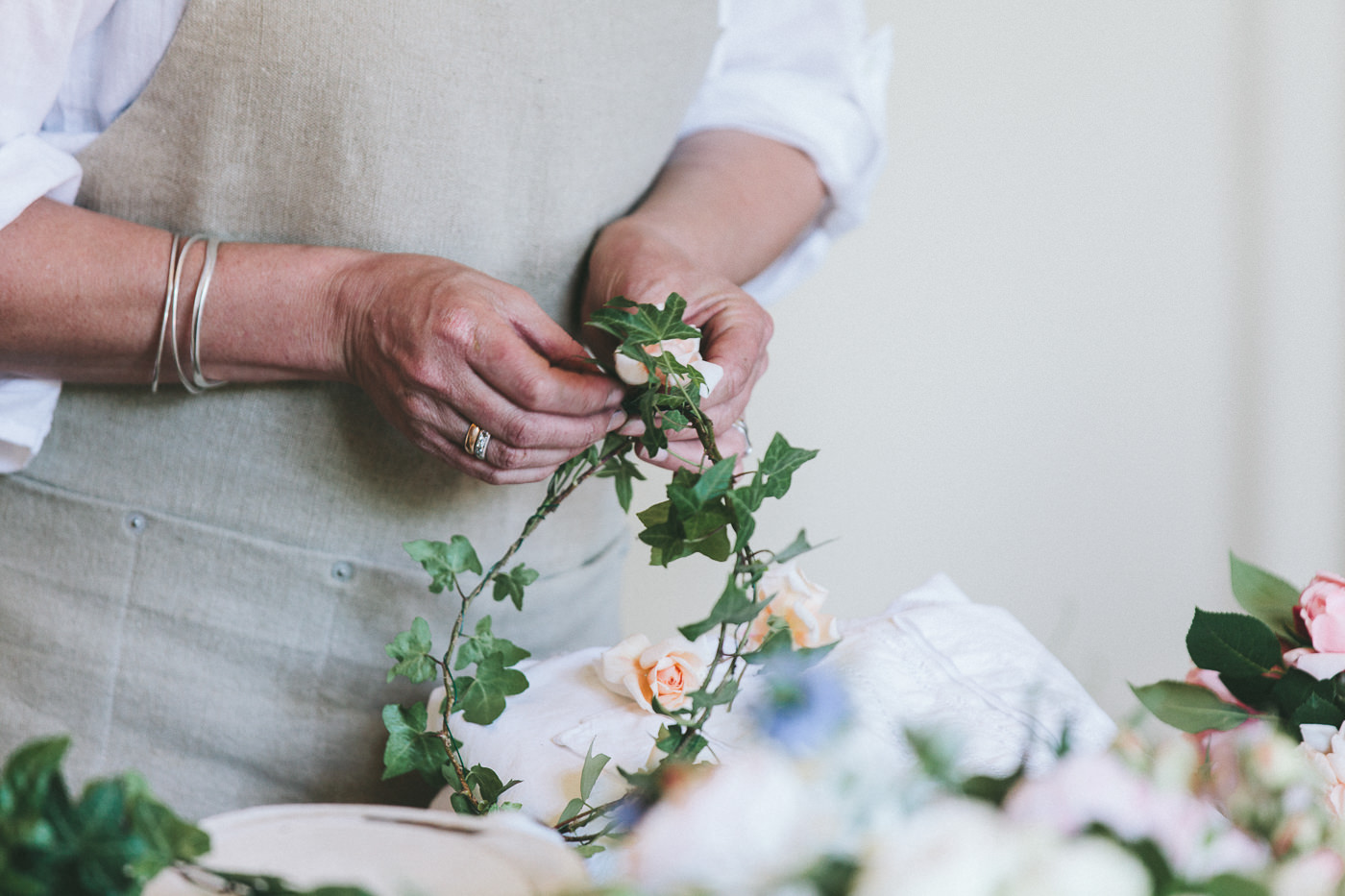 Stylist at work on floral crown