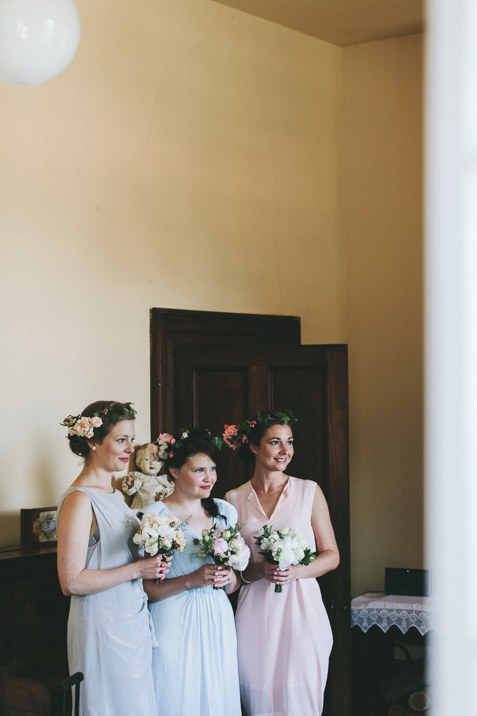 Bridesmaids with bouquets and floral crowns