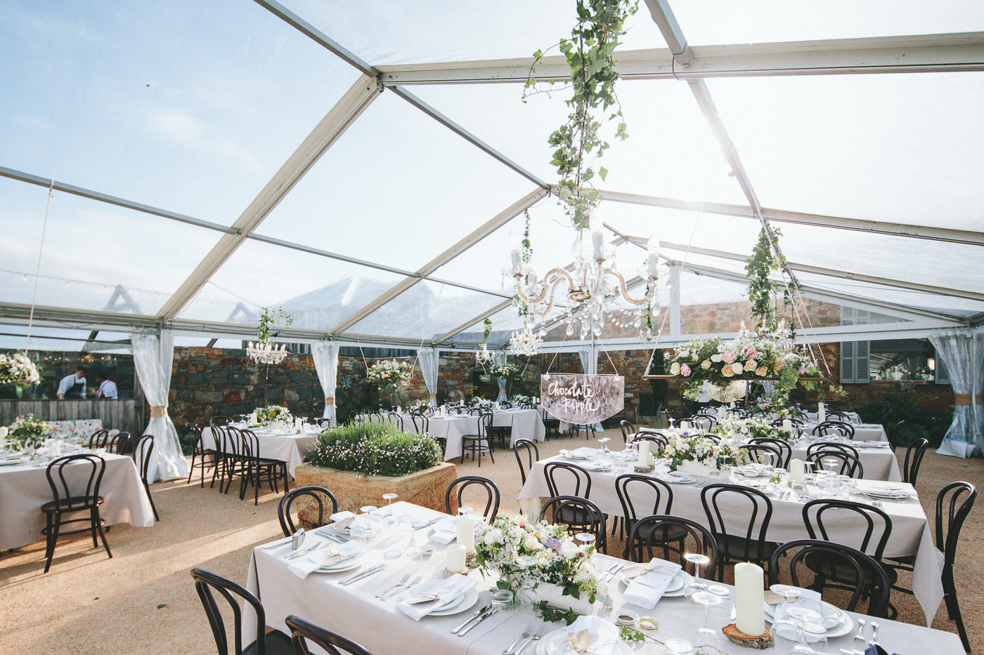 Clear marquee with Chandeliers, Bentwood chairs
