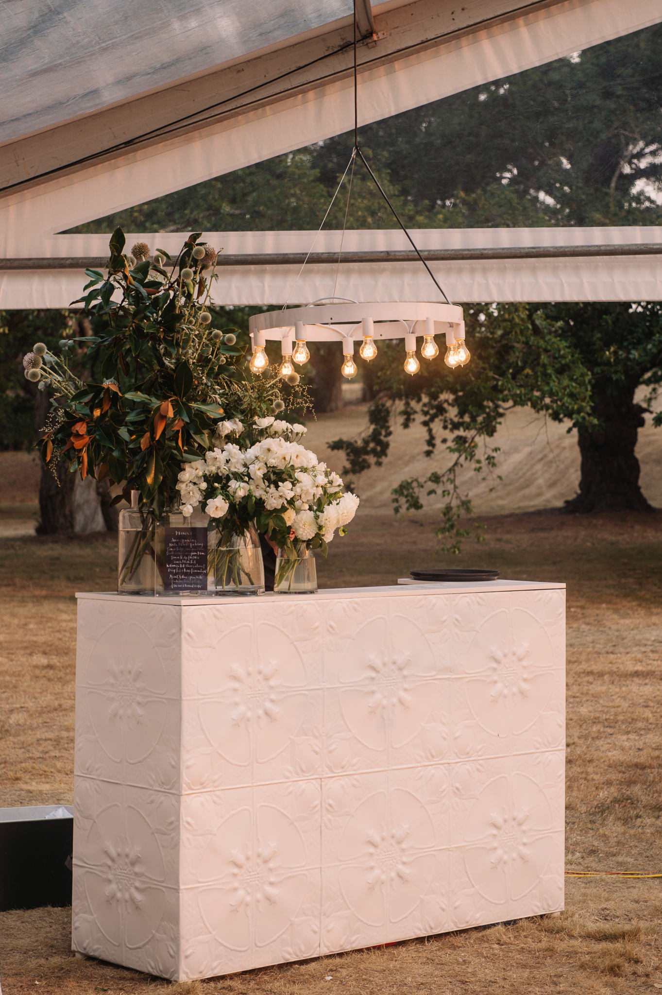Pressed tin bar and custom lighting for the reception