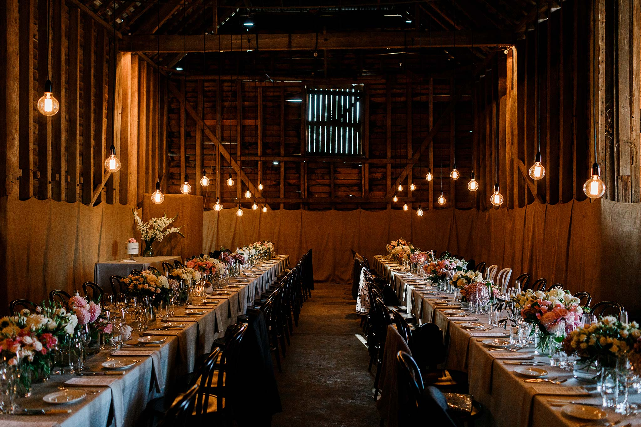 Brickendon barn set for intimate dining with custom lighting