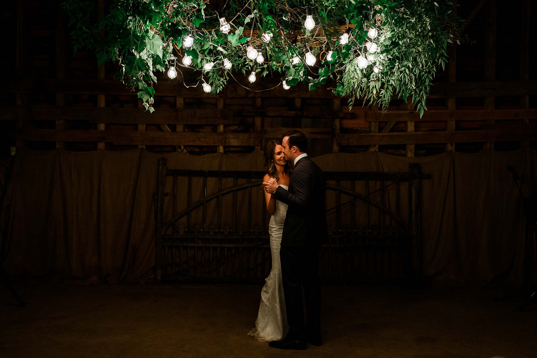 First dance under the custom made foliage chandelier