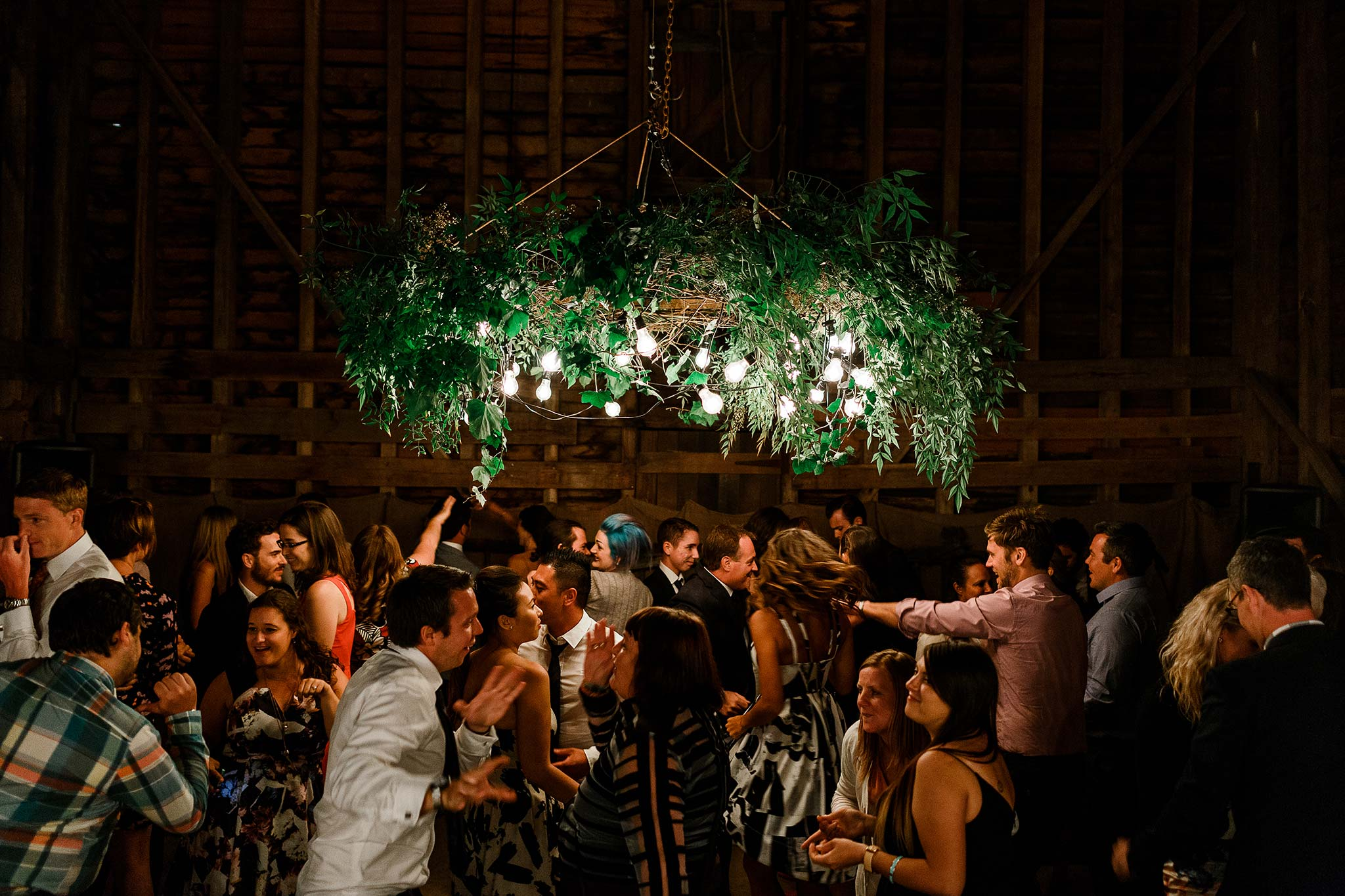 Dancing the night away under the custom made foliage chandelier