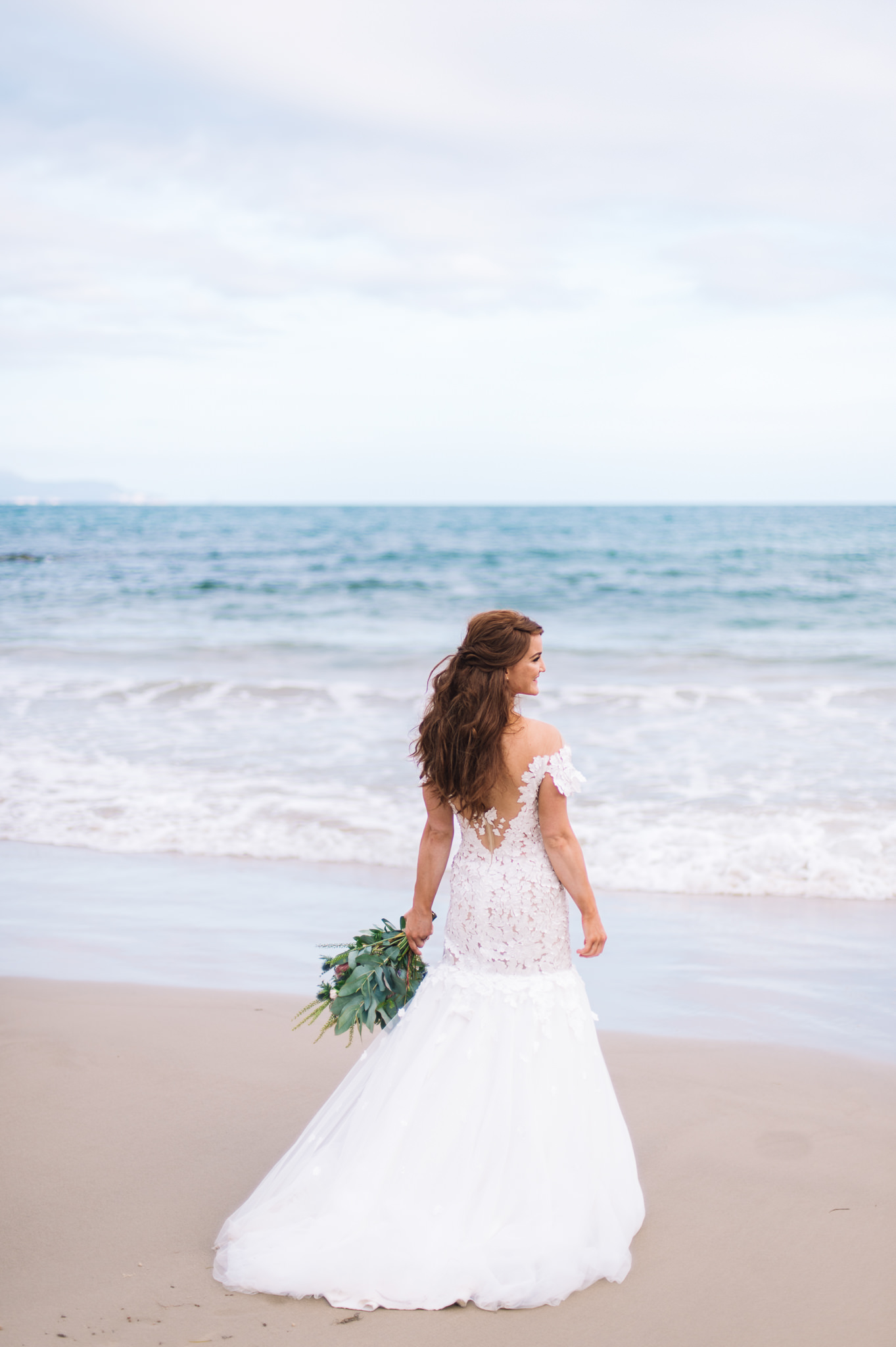 Beautiful Nurit Hen gown on Avalon Coastal Retreat's private beach
