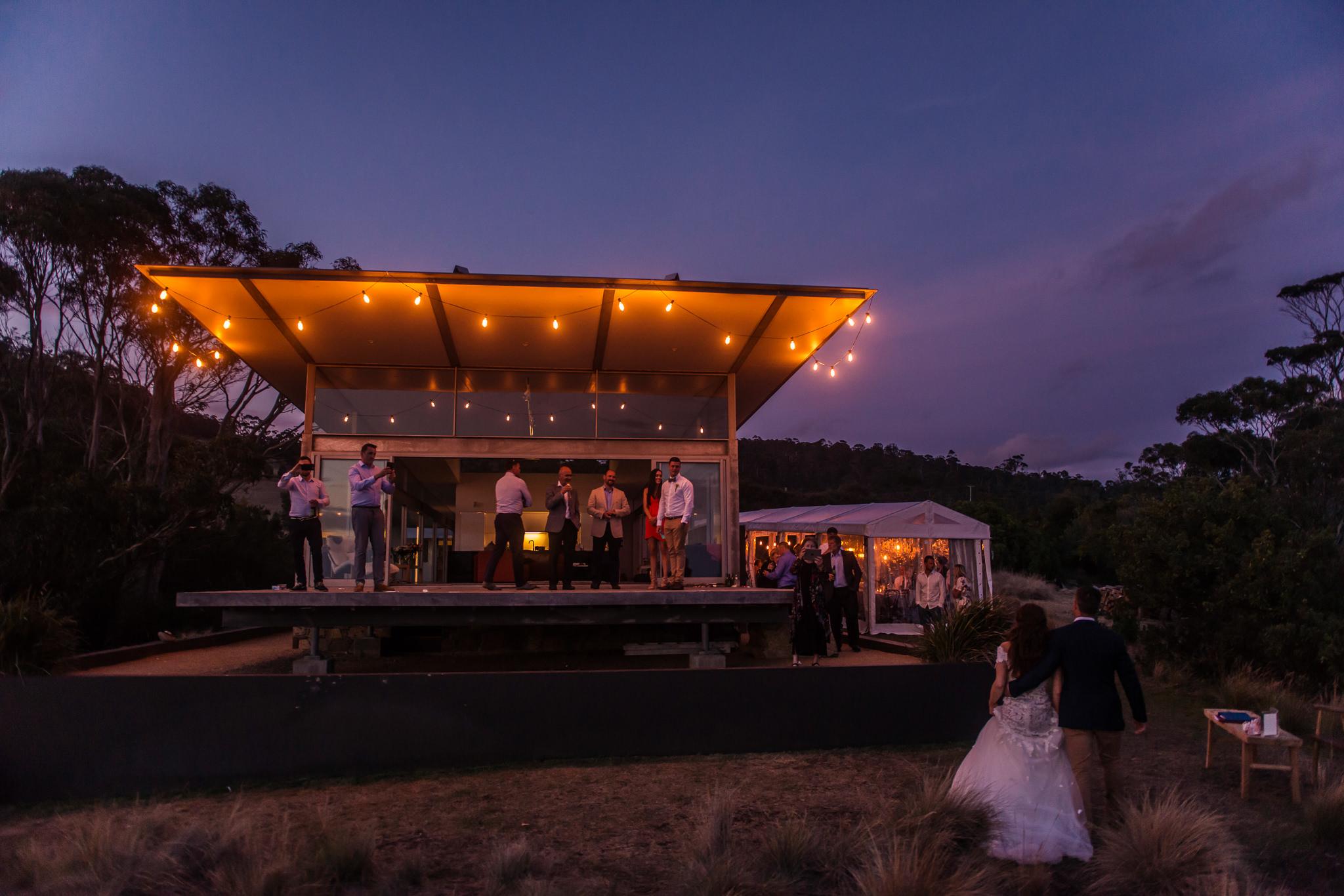 Avalon Coastal Retreat with custom lighting after sunset