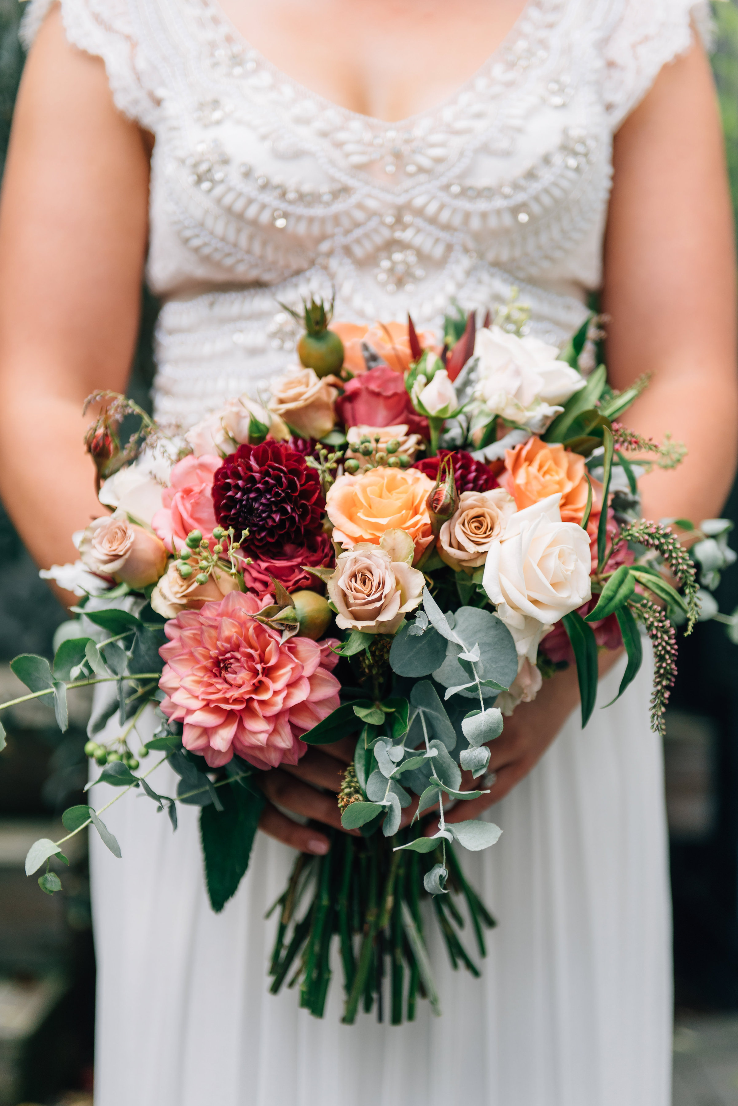 Bride in Anna Campbell gown and bouquet by Bek Burrows