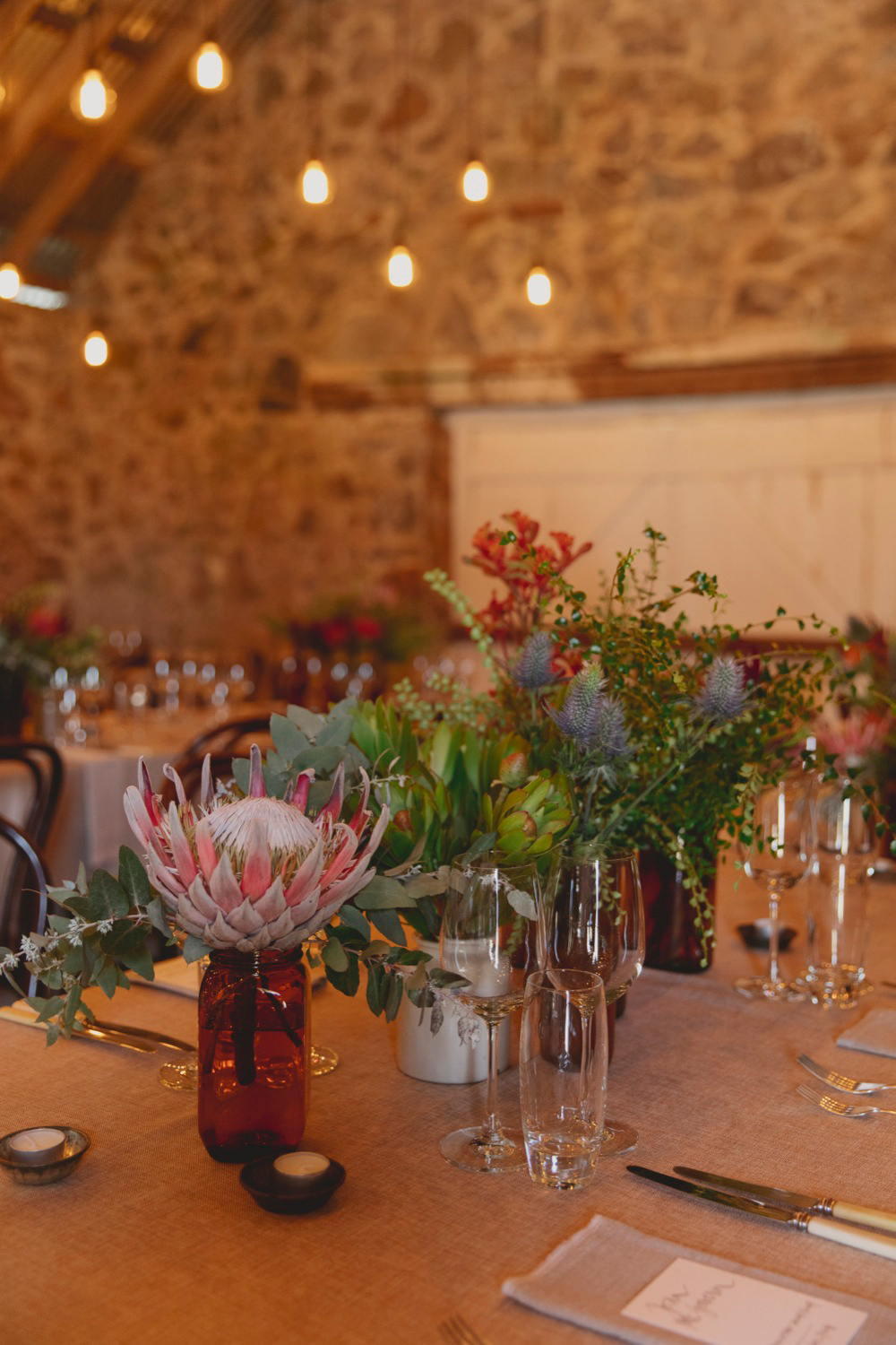 Native floral and vintage silverware on the tables