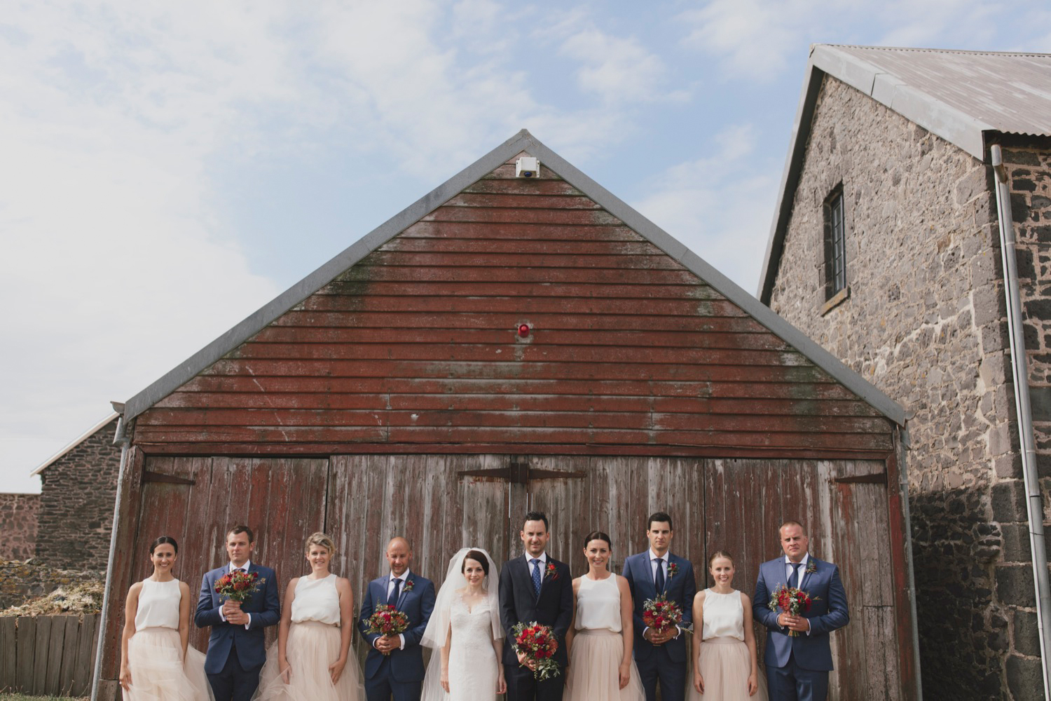 Bridal party outside the barn at Highfield House, Stanley, Tasmania
