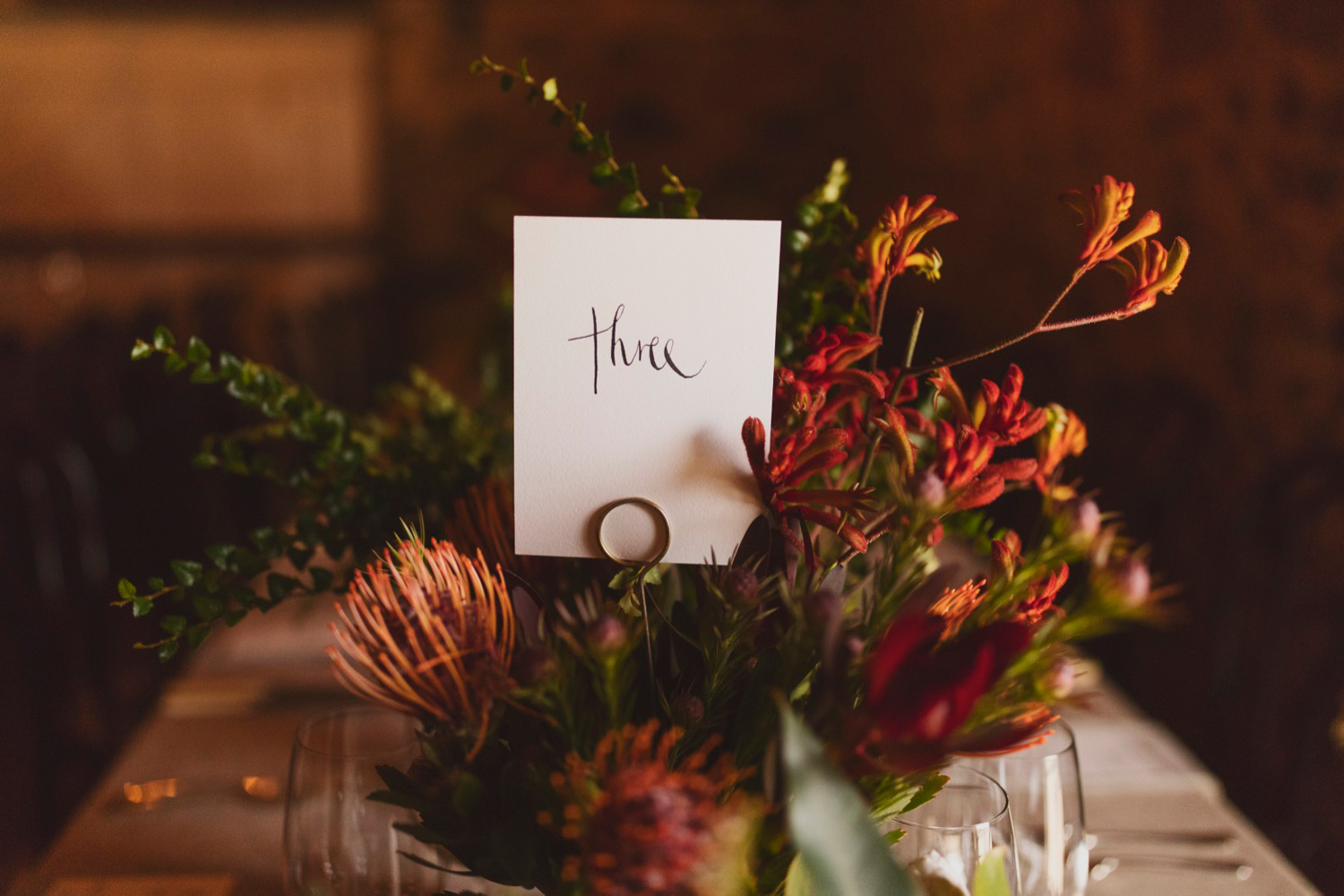 Native flowers and hand written detail on the simply styled tables.