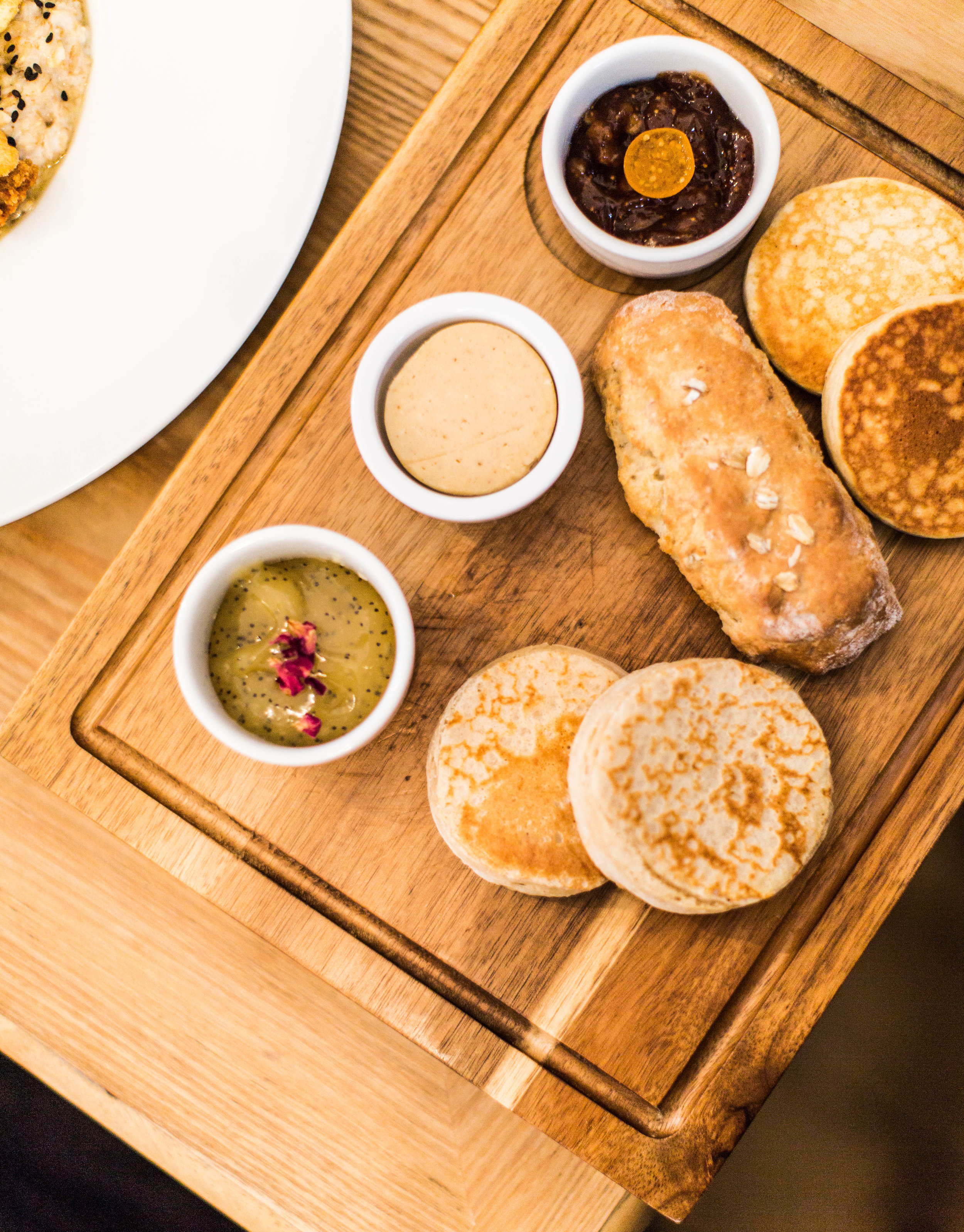 The pikelets, drop scones and oat bannock, alongside lemon and poppyseed curd, that amazing spiced maple butter, and fig and orange marmalade.