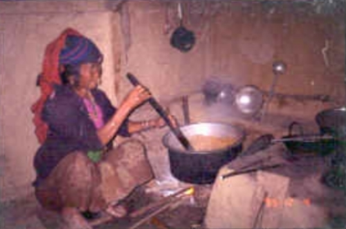 Nepali woman cooking soybeans to make  kinema