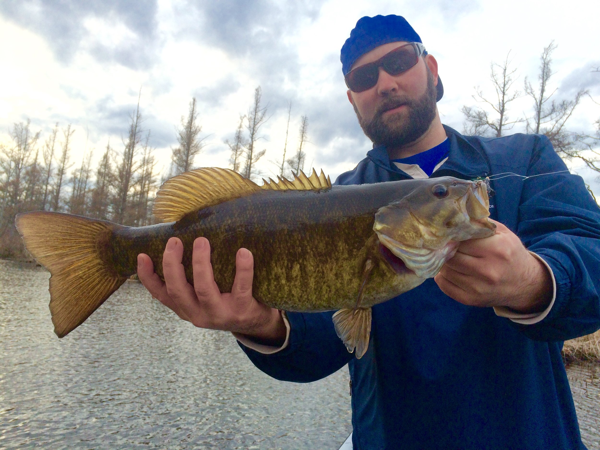 "Photo:   Fly Factor client Ben Hughes with an April 2016 pre-spawn giant 20 ¼"" personal best smallmouth on-the-fly. The fish ate a proven custom leach pattern Brett tied."