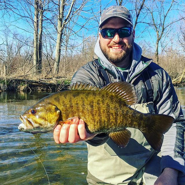 Taco grip Tuesday - Rob with a beauty #flyfactor #smallmouth #michigan #flyfishing #hydedriftboats #simmsbass
