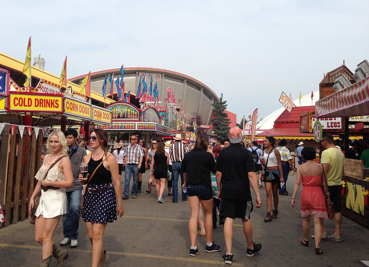 Strolling down the path between the food kiosks at the Calgary Exhibition and Stampede