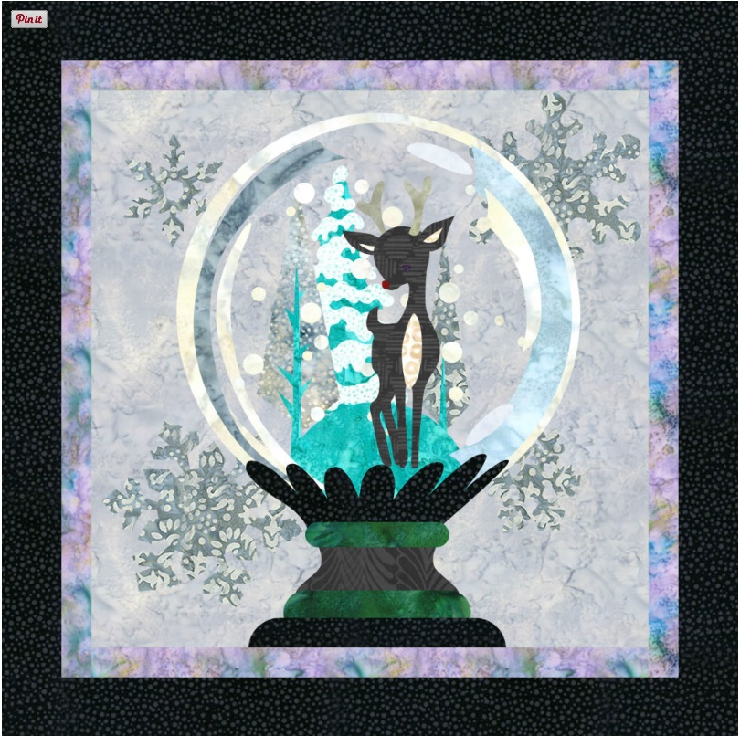Snow globe design on quilt gallery on QuiltFusion. Photo courtesy of www.quiltfusion.com