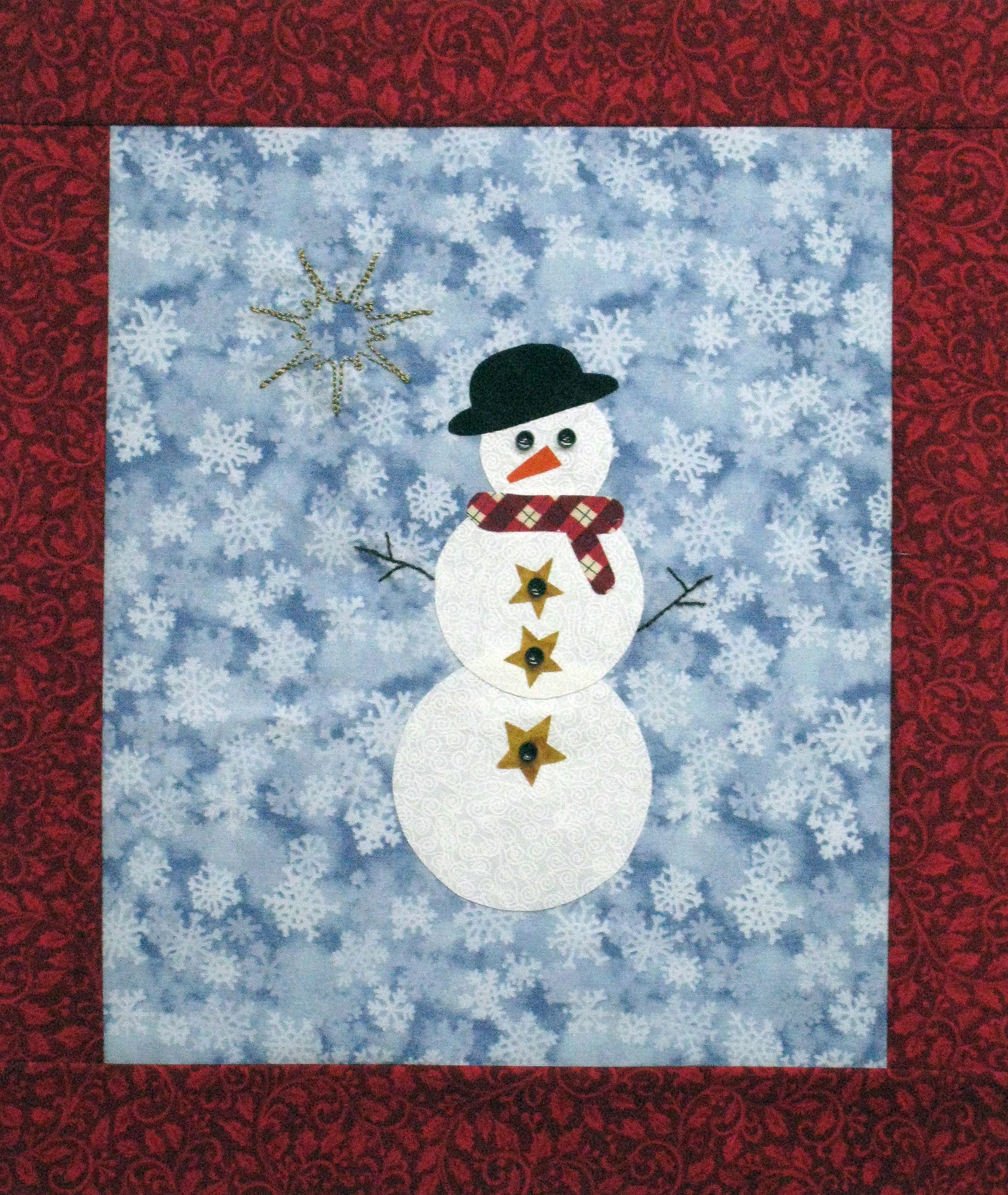 Snow Cool by Chatterbox Quilts uses hand embroidery and fusible web appliqué to create a small wall hanging.