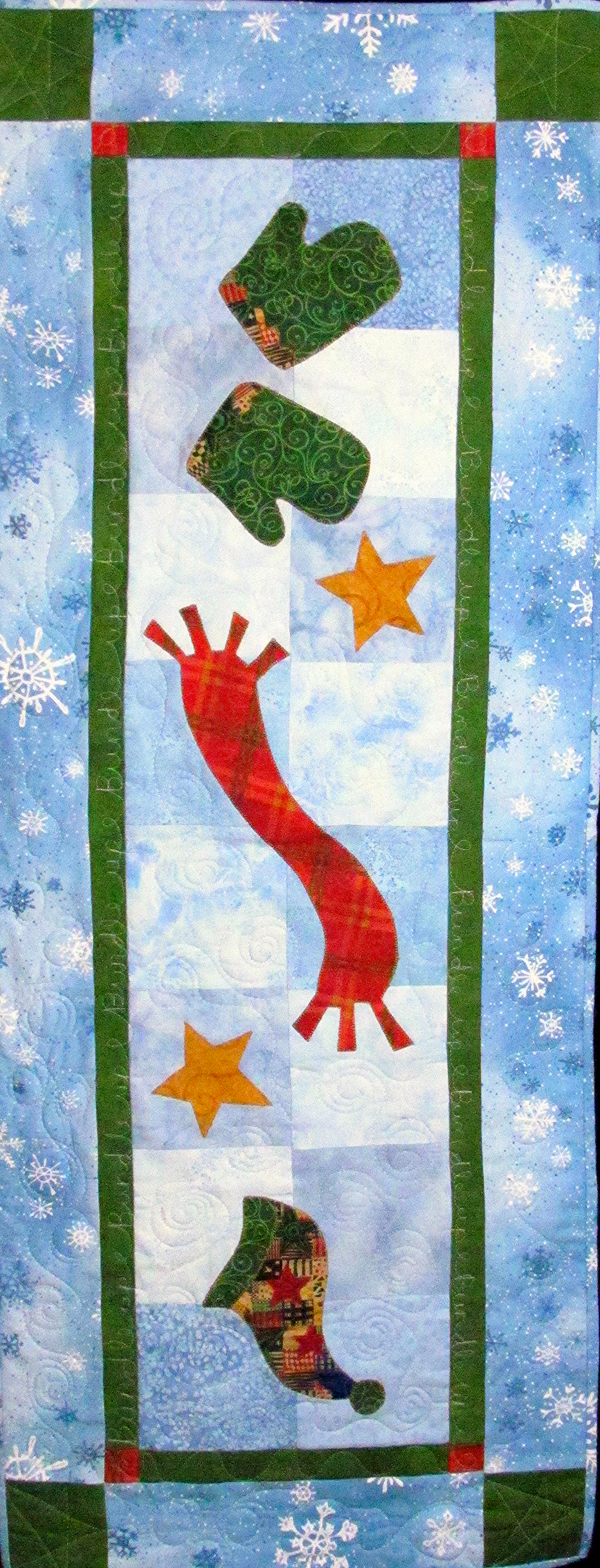 Bundle Up by Chatterbox Quilts can be either a table runner or a wall hanging.