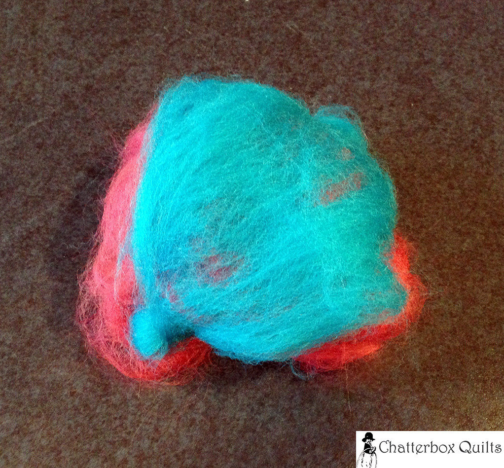 Layers of wool roving ready for felting