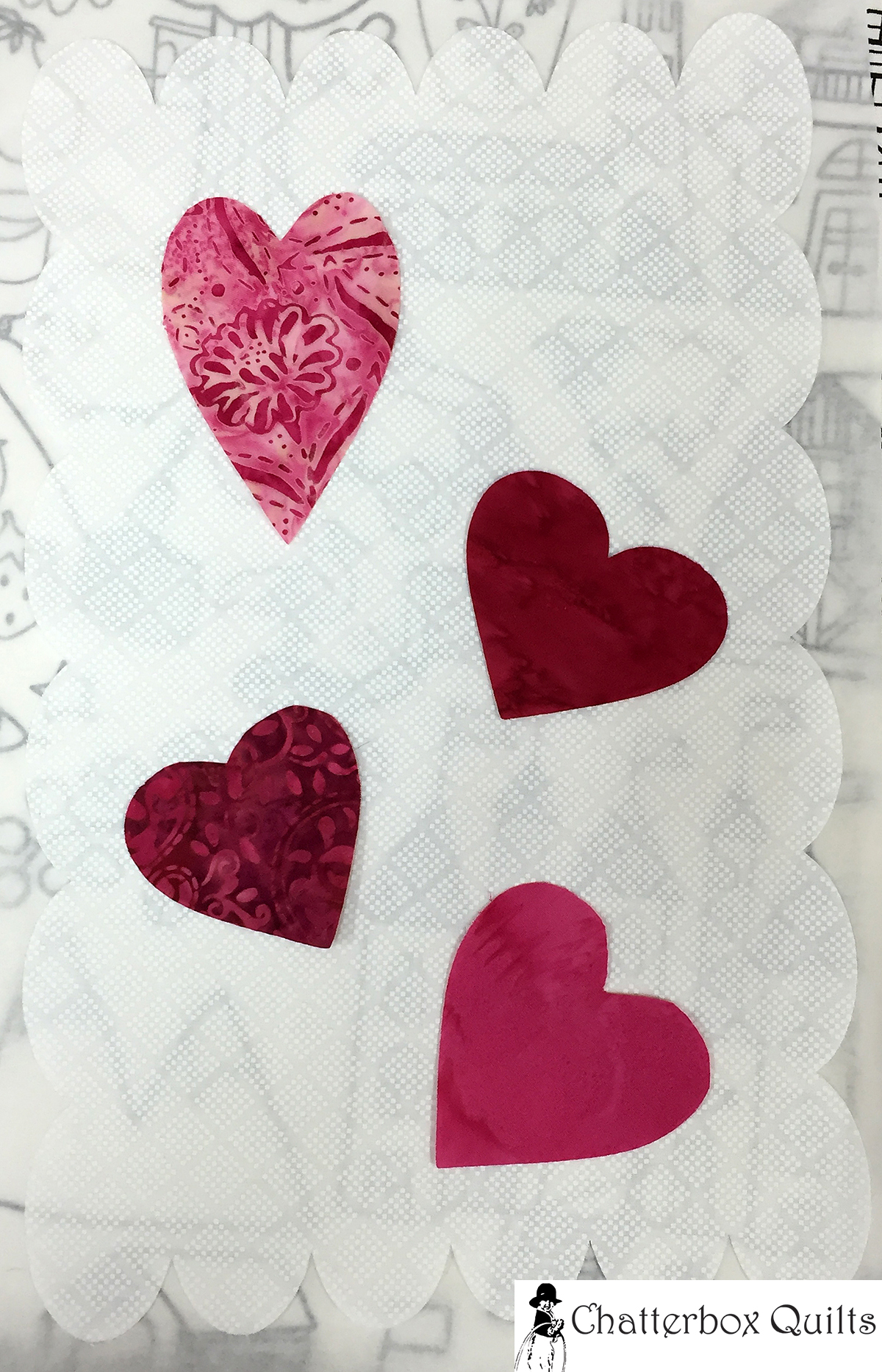 Hearts fused to the scalloped appliqué background